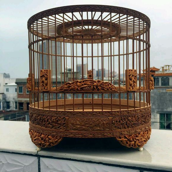 An exquisite Chinese bird cage with woodcarving